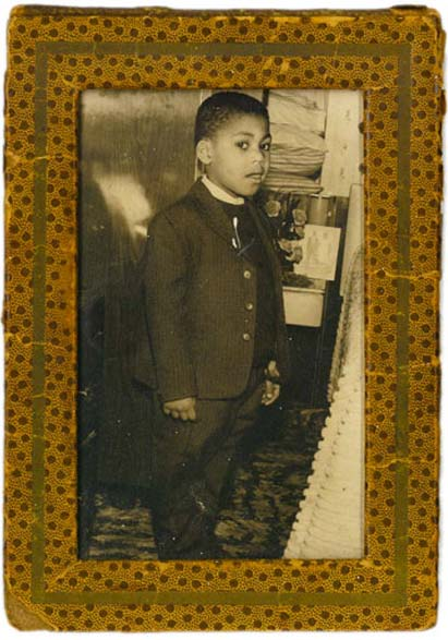del pictured in a suit as a child