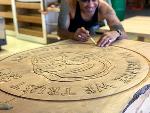 Photo of Del Fine Artist working on Head of Table wood carving