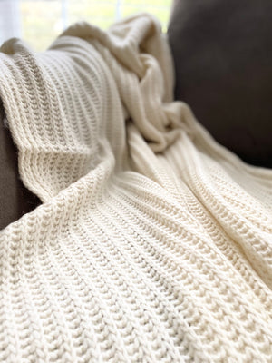 The Modest Decor cable knit throw.