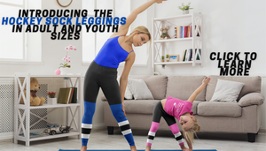 An adult woman, stretching while wearing blue hockey sock leggings and a child wearing pink hockey sock leggings and the