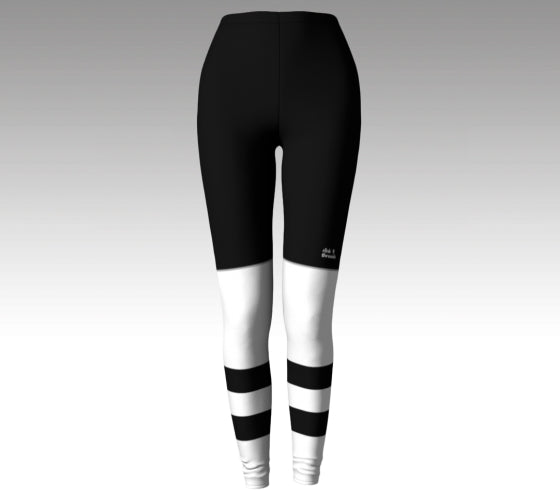 "Mockup of leggings The leggings have a graphic that look like black hockey pants (with a Rink Threads logo above the left knee and ""Rink Threads"" Written up the side in white) and white hockey socks with two white stripes and a black stripe between them."