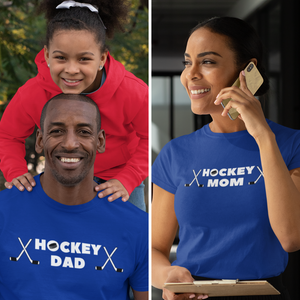 "Split screen  photo. On the left is a middle aged man with a child resting her chin on his head, standing over him. He is wearing a royal blue t-shirt with ""Hockey Dad"" written across the chest. There is a puck in the ""O"" of hockey and two croassed sticks on either end. On the right is a woman on the phone, wearing the same shirt but instead of ""Dad"" it reads ""Hockey Mom"""
