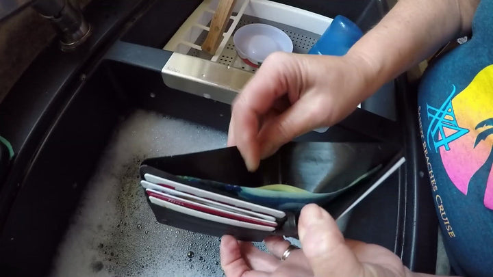 Video of The Washsable wallet where the actor washes cash, and then submerges and washes the wallet along with the cash.
