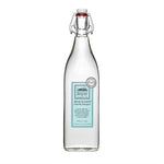 This vintage looking glass bottle is a great vessel for sustainable, biodegradable laundry detergent. This one has a blue label on it to denote its beachy scent.