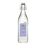 This vintage looking glass bottle is a great vessel for sustainable, biodegradable laundry detergent. This one has a purple label on it to denote its lavender scent.