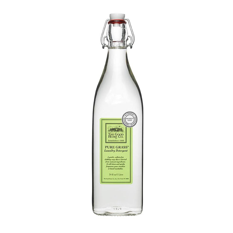 This vintage looking glass bottle is a great vessel for sustainable, biodegradable laundry detergent. This one has a green label on it to denote its grassy scent.