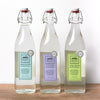 Three bottles of laundry detergent, each a different scent. (Beach Days, Lavender and Pure Grass!) The bottles are classic (they look almost like vintage French bottles) and can be reused infinitely around the house, making them a more sustainable choice.