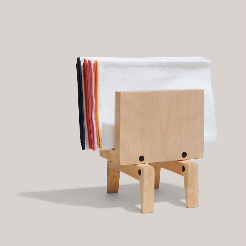 A birch napkin holder holds four napkins in this plain frame. The napkin holder is made from plain birch wood and can hold as many as six napkins. A beautiful addition to any tablescape--weather you love bright, vibrant colors or basic neutrals.