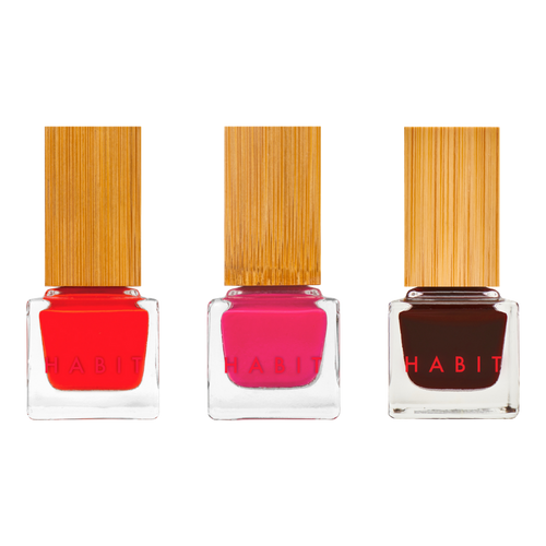 Here's the full suite of nail polishes. On the left is a vibrant coral red, in the center a warm magenta, and on the right an oxblood.