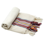 A 100% linen and cotton neutral turkish towel with a brightly colored striped detail down the center of the towel, ending with tassel accents. Here, the towel is half-rolled one to two inches--perfect for a bathroom of any size.