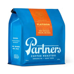 Do you love product images on 45 degree angles, snuggling up with a cozy oversized braided blanket, plush turtleneck, cuddling a piping hot mug of coffee? Partner's FLATIRON coffee is the flavor for Y-O-U! This bright blue bag of Partner's coffee is made punchier with an even brighter orange label--tasting notes (you're gonna love this one, I can tell) include dark chocolate, praline and dates. An easy way to make your day that much more decadent.