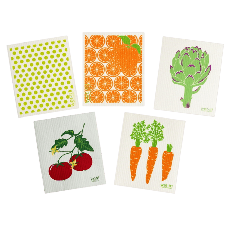 This set of 5 reusable and biodegradable sponge cloths are all white, each with a different print on them. One has green polka dots, one has orange slices, one has an artichoke, one has tomatoes and one has carrots.