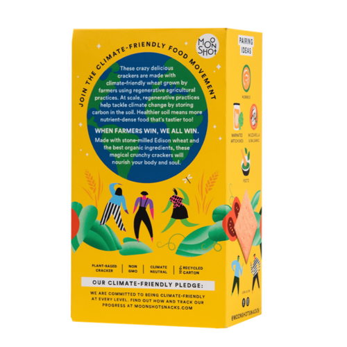 This is the back of Moonshot's climate friendly tomato basil cracker box. It features illustrations of women dancing and green vines below an illustration of a green and blue globe. The globe also has white writing over it that describes Moonshot's regenerative agriculture practices.