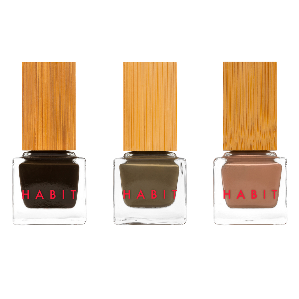 Three beautiful sustainable 10-free nail polishes. From right to left, a chocolatey deep brown-green, a kelly/hunter green, and a tan mocha.
