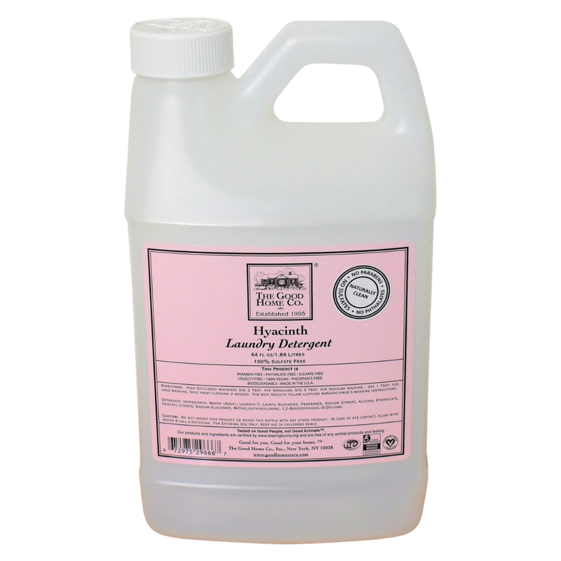 A large gallon container of laundry detergent, with a floral scent and bright pink label.