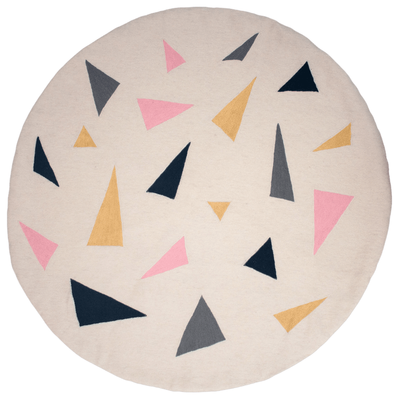 Natural fiber round rug with hand embroidered design, complete with lots of different shapes and sizes of triangles in grey, slate, pink and gold.