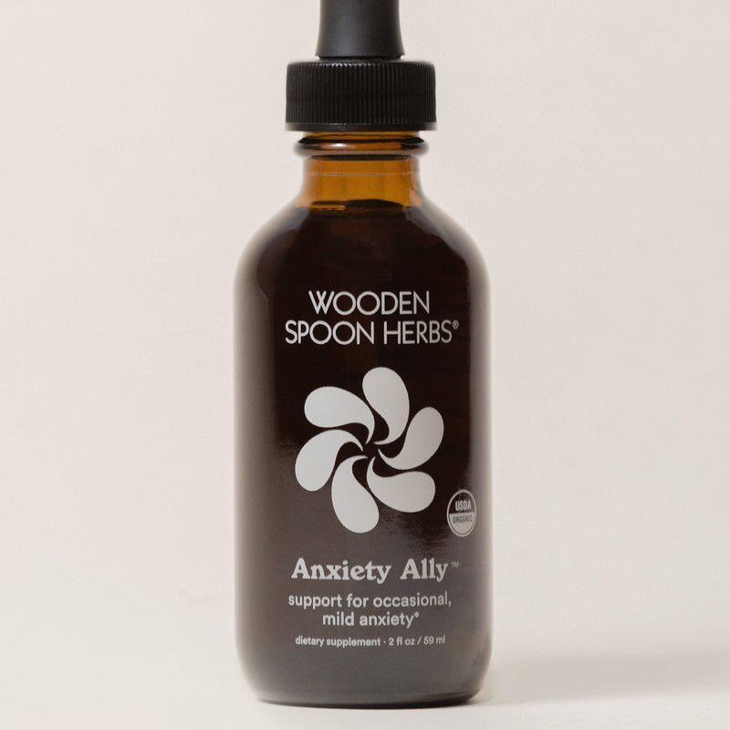 A silo image of an amber glass tincture bottle containing your most trusted friend this year--we'll call her, your Anxiety Ally. Melt your worries away with a few drops of these organic, eco-friendly, natural drops.