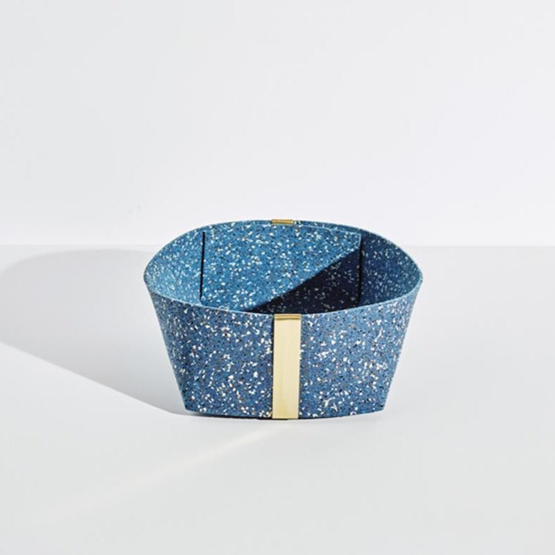 The largest blue speckled basket with gold accents sits on a plain white background.