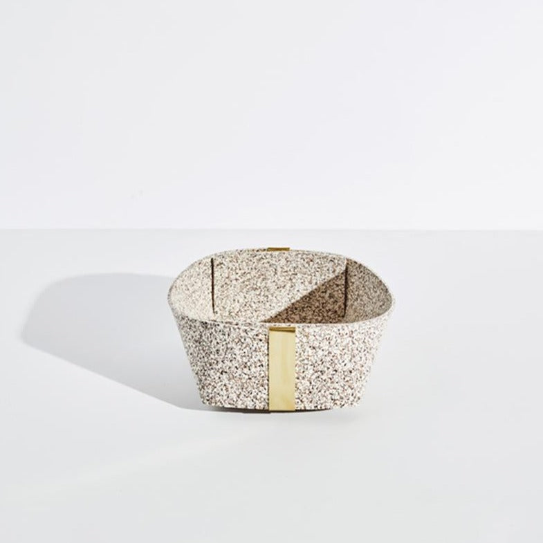 The medium sand speckled basket with gold accents sits on a plain white background.