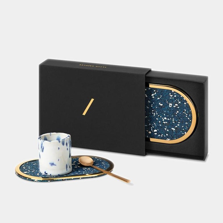 These royal blue brass edged coasters are made of recycled rubber. Here we can see them in action, including the beautiful giftable box they come in.