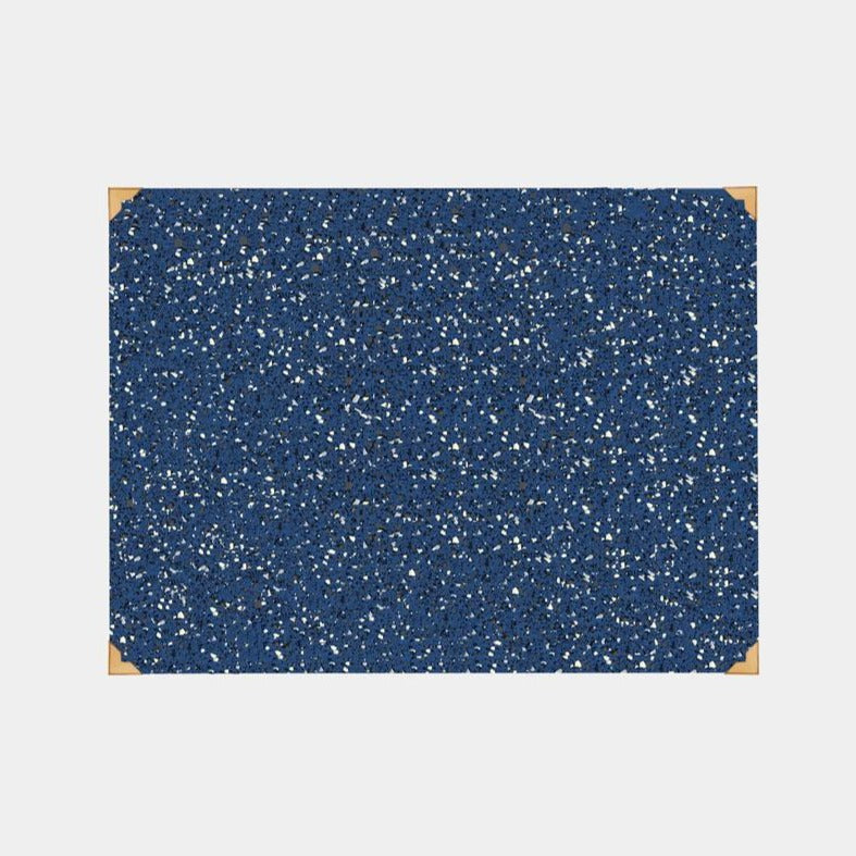 Speckled royal blue terrazzo reycled rubber desk mat with luxe brass corner accents.
