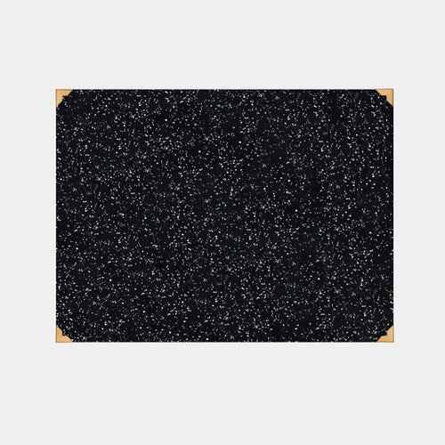 Speckled black terrazzo reycled rubber desk mat with luxe brass corner accents.