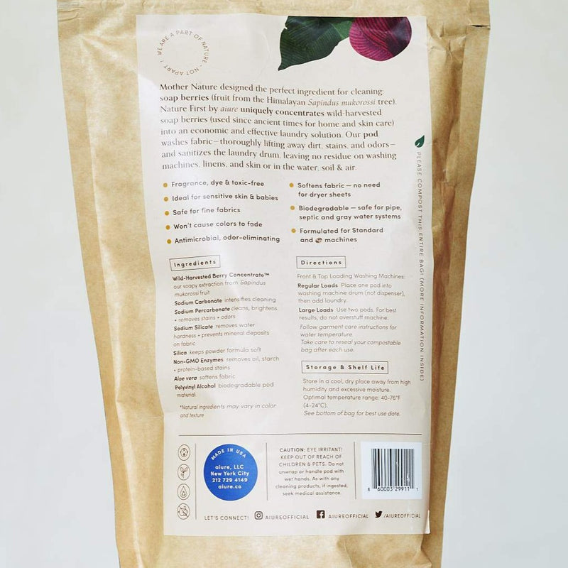 The back of the kraft paper bag full of biodegradable laundry detergent made of soap berries. It shows all of the natural and non toxic ingredients and talks about the shelf life and product use directions.