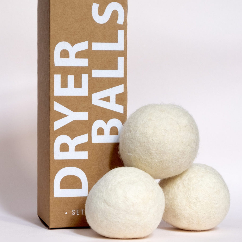 Here are three tennis ball sized wool felted dryer balls made from upcycled wool from family farms. The balls are white, like sheepskin, tennis ball sized, and each set includes 3.