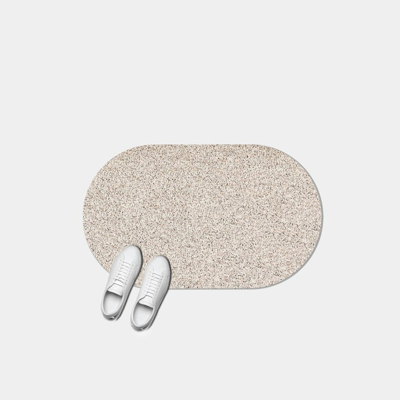 This sand colored recycled rubber floor mat is perfect for indoor and outdoor use. The material is super nice and speckled because of the way it's sustainably made in a closed loop system.