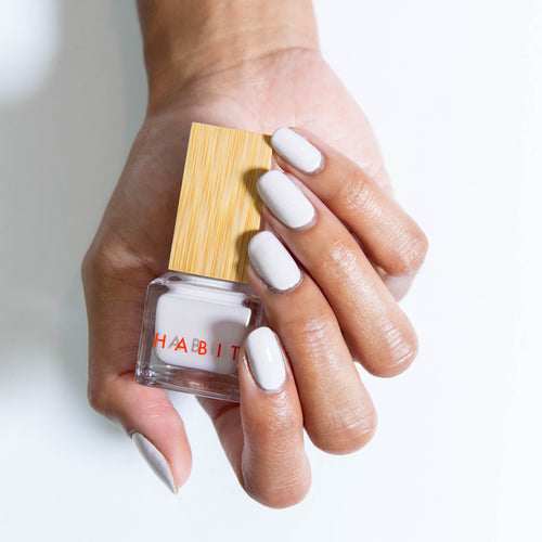 This is the lightest nail polish shade in the bundle, pearlescent and a cool, soft grey or white.
