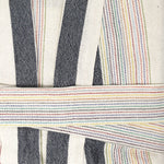A very close-up shot of the robes texture & belt shows thick (around 0.25 inch) grey stripes and incredibly thin set of rainbow stripes of all colors (orange, red, yellow, green, red, light blue). Made from 100% linen and cotton, the robe's texture is thin yet absorbent.