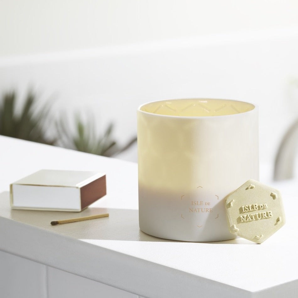 Isle de nature luxury candle is made of hand crafted clay with a sustainable wax center.