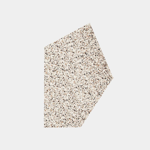 A sand speckled pentagon shaped mousepad sits in the middle of a plain white background.