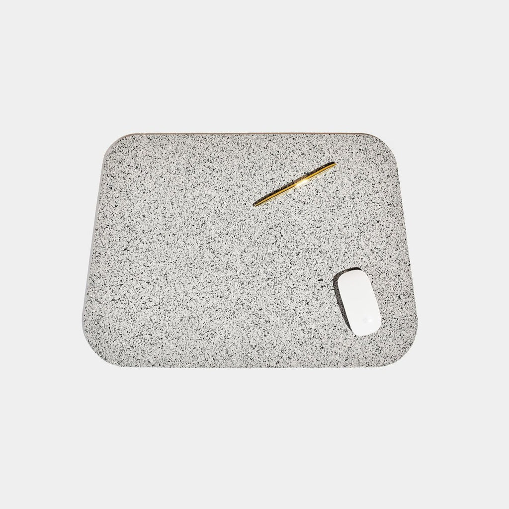 Speckled grey terrazzo deskmat with rounded edges. It's made of a super sustainable recycled rubber material by hand in the US.