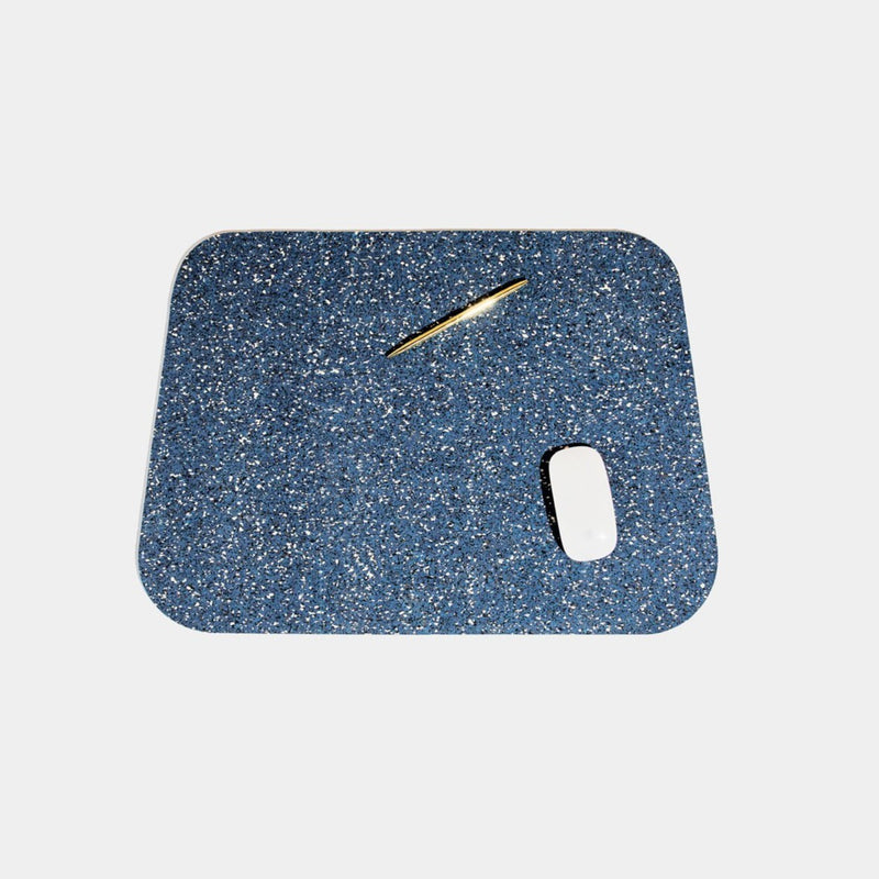 Speckled royal blue terrazzo deskmat with rounded edges. It's made of a super sustainable recycled rubber material by hand in the US.