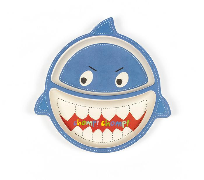 "A children's dinning plate--that measures 10"" x 11"" x 3""--is found here. Made into the shape of a shark, the plate is blue, has a shark's face, and three fins on its side. The mouth of the shark also has ""chomp! chomp!"" in rainbow writing."