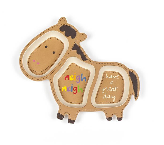 "A single dinner plate for children sits in this plain frame. The plate is in the shape of a horse in a light brown tone. The center of the plate says ""neigh neigh"" in rainbow letters, the butt area of the horse says ""have a great day"" in white lettering, and the plate measures 10"" x 11.5"" x 3""."
