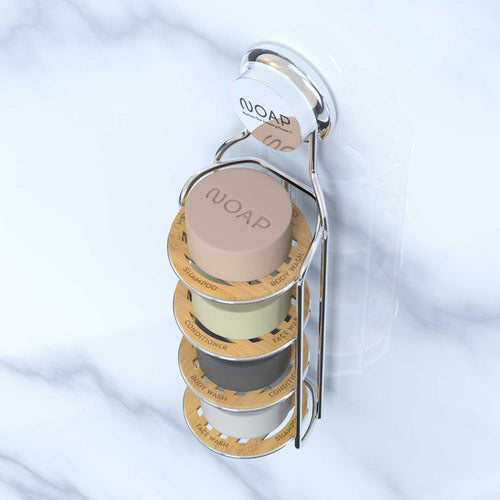 This shower rack uses labeled bamboo coasters to lift your soap, cleanser, shampoo and conditioner bars up and to keep them high and dry, where they'll last longer. It uses a clever suction cup to attach to your shower wall, easy peasy!
