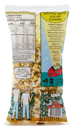 The back of a Bjorn Qorn popcorn shows the nutrition facts and caloric information on the left side. The bottom left side shows a drawing of two men standing in front of corn stalks. The right side features copy on Bjorn Qorn's solar power while the bottom right side shows two blue birds having a picnic in corn stalks.