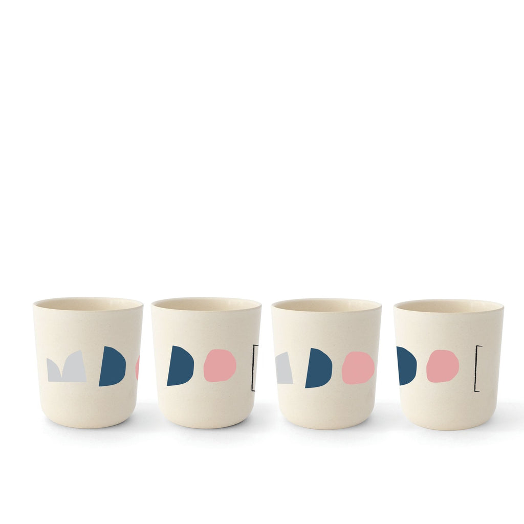 4 bamboo cups feature geometric designs set against a bamboo ecru background. The cups are great sizes for children, but also work for adults who want to sip water or juice or anything that might fit into a small glass.