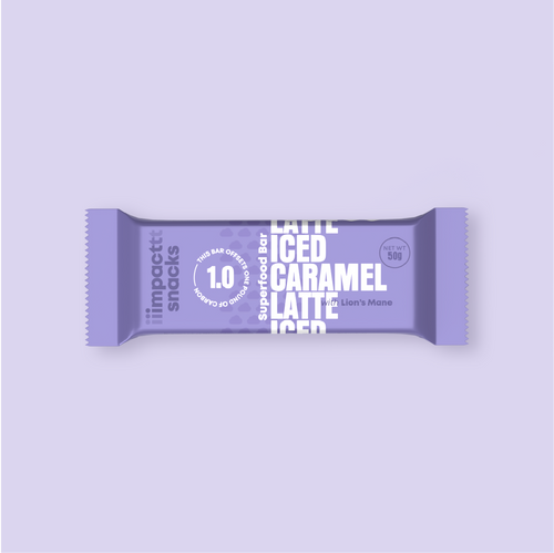 A violet impact snacks bar is placed vertically in the center of this light purple frame. The bar is labeled as an Iced Caramel Latte bar in white writing on the violet packaging.