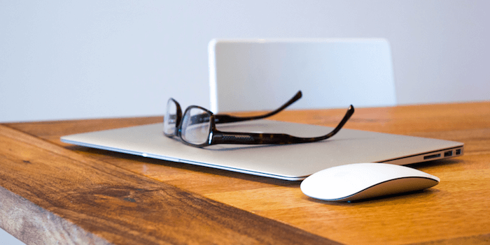 Laptop and glasses on table