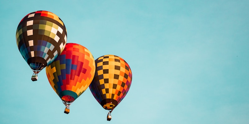 Three hot air balloons in the sky