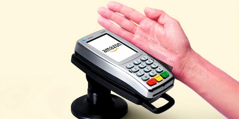 Person paying by card with their hand