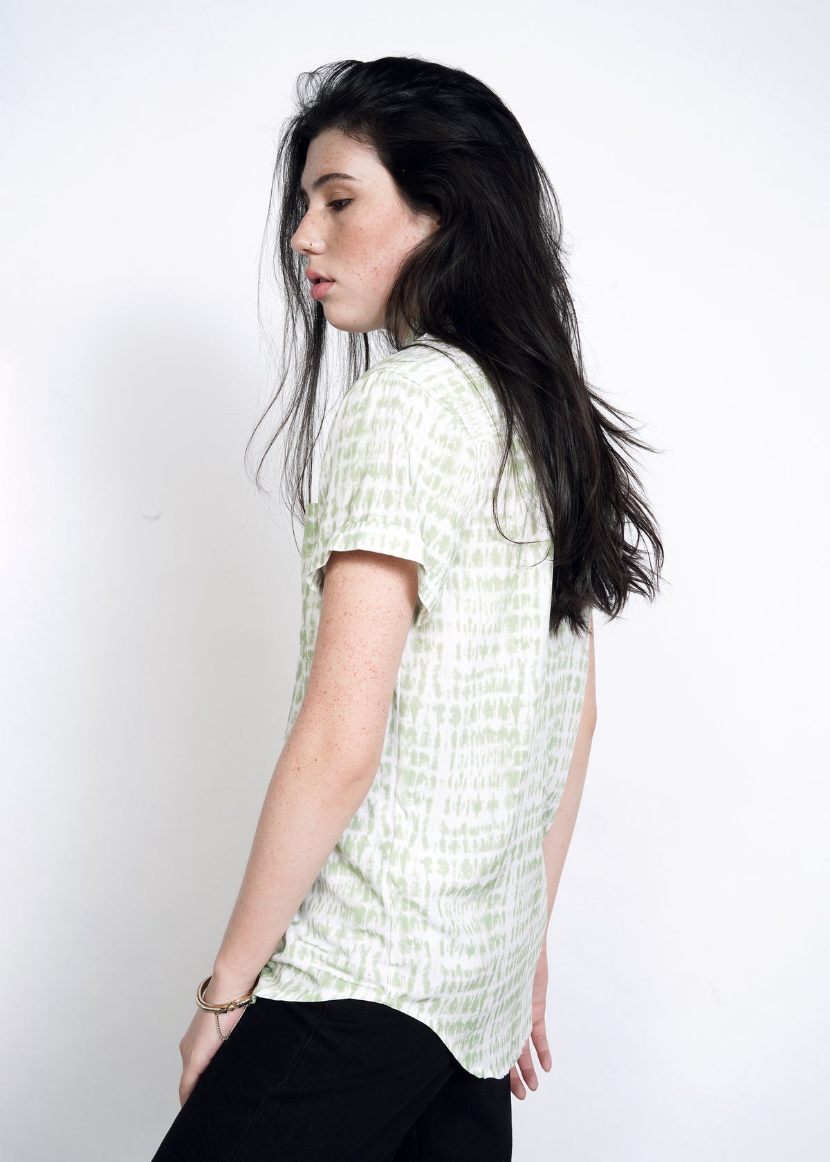 Side view of model wearing celadon green shabori print loose fit button up