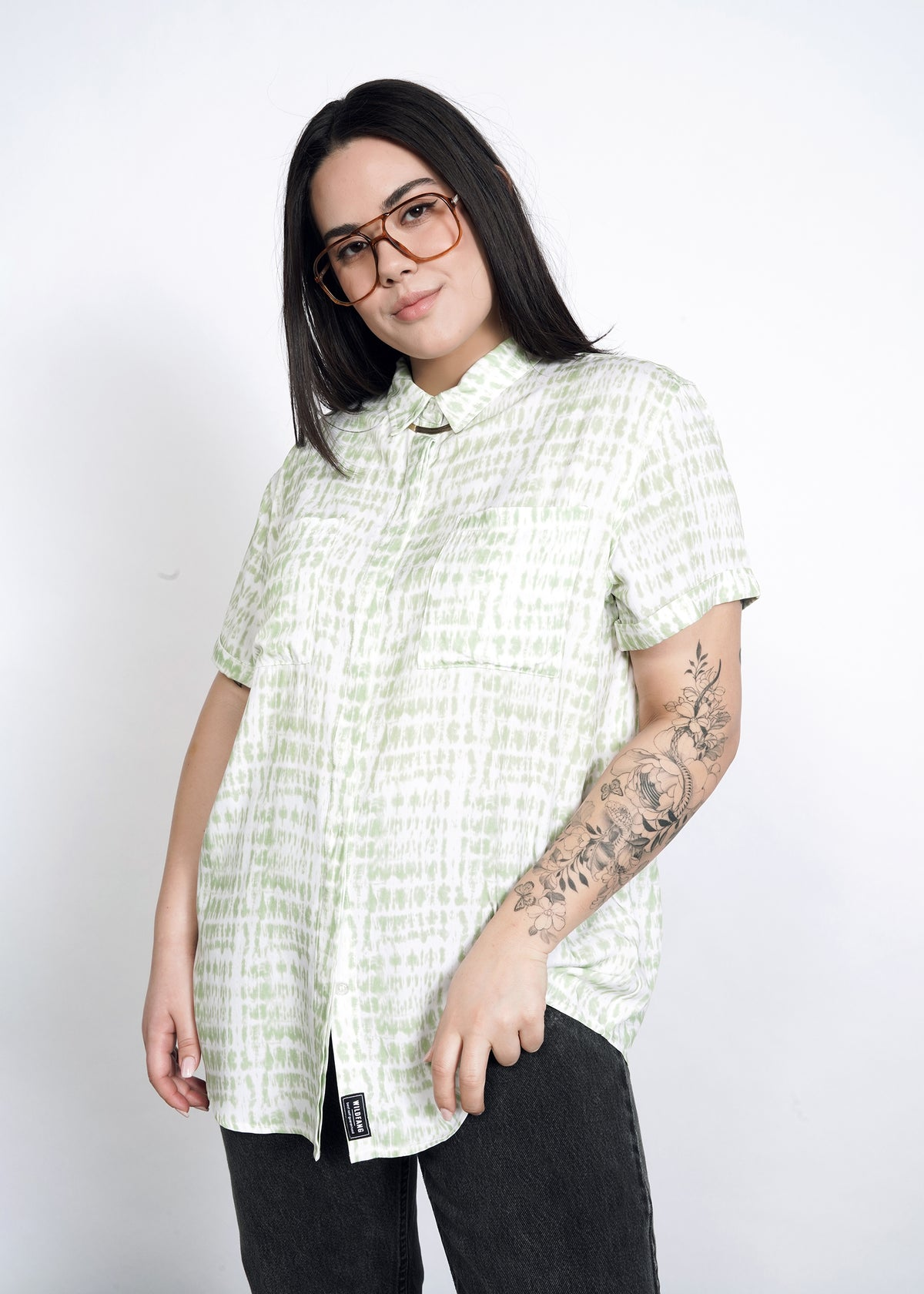 Model wearing celadon green shabori print loose fit button up in size large, buttoned all the way to the top