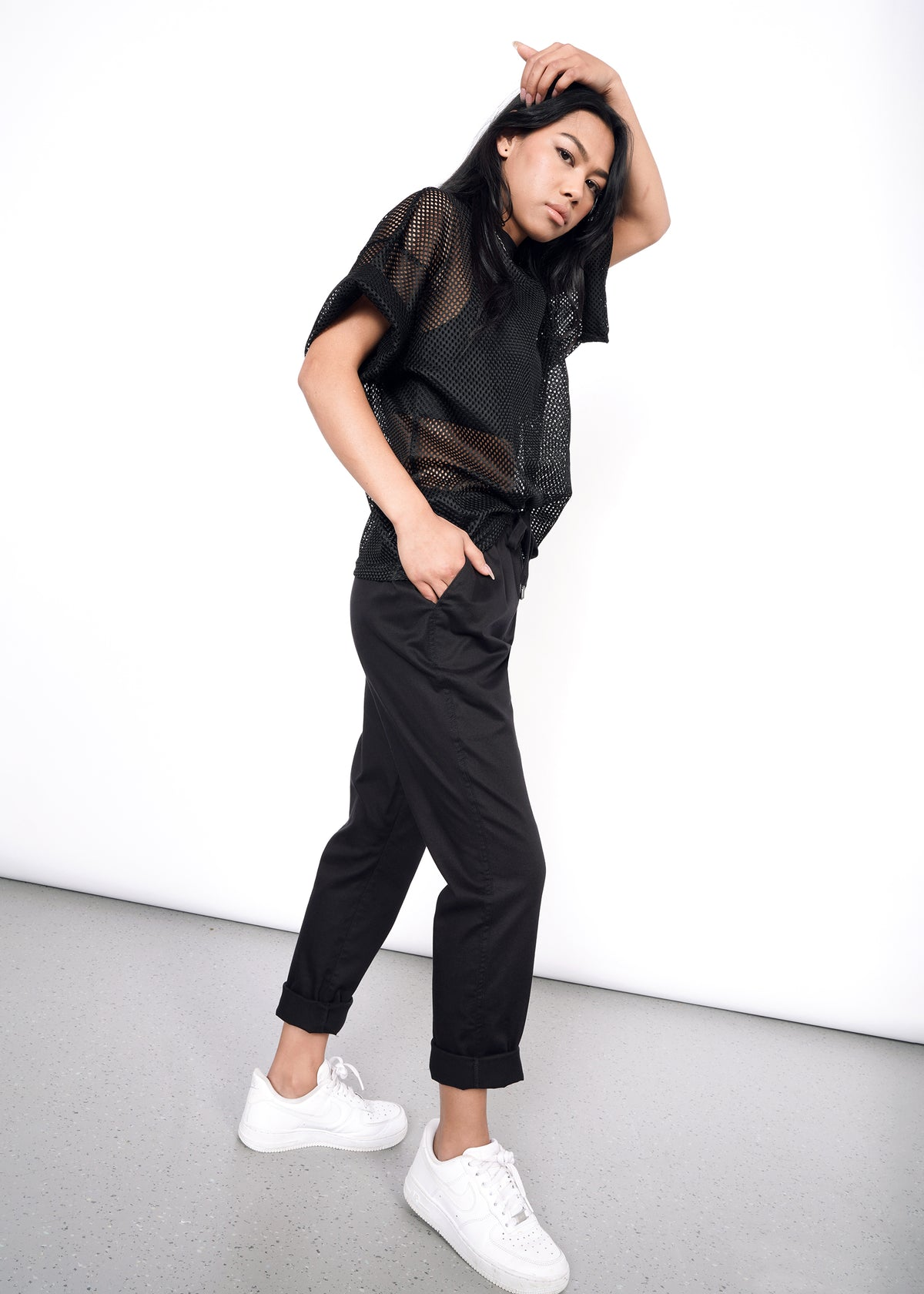 Sideview of black drawstring pant on secondary model