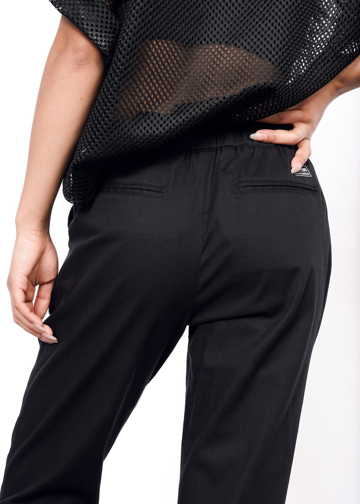 Back closeup view of black drawstring pant on secondary model, shows two pockets