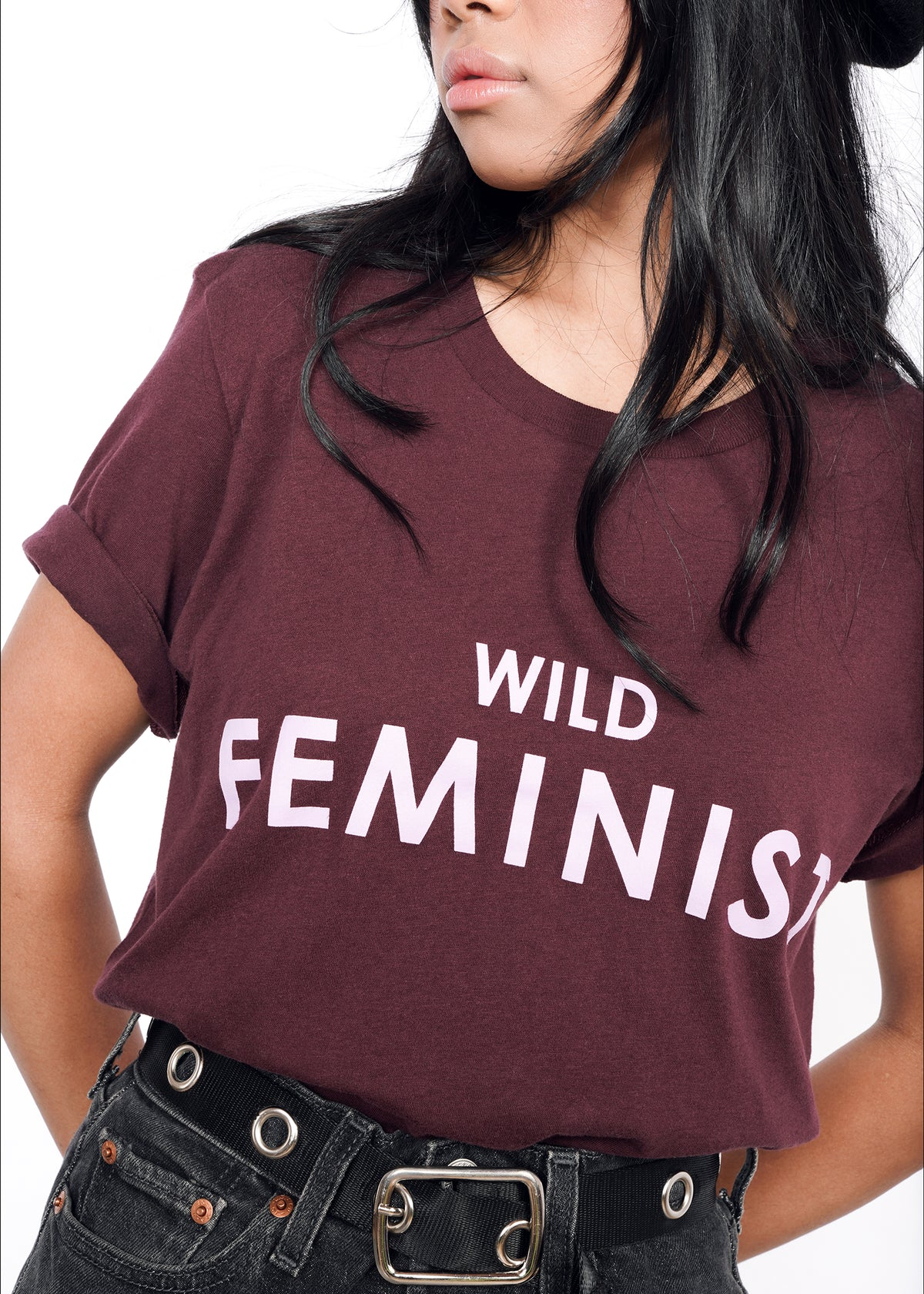 "Closeup of chest of merlot burgundy colored short sleeve tshirt that reads ""WILD FEMINIST"" in light purple"