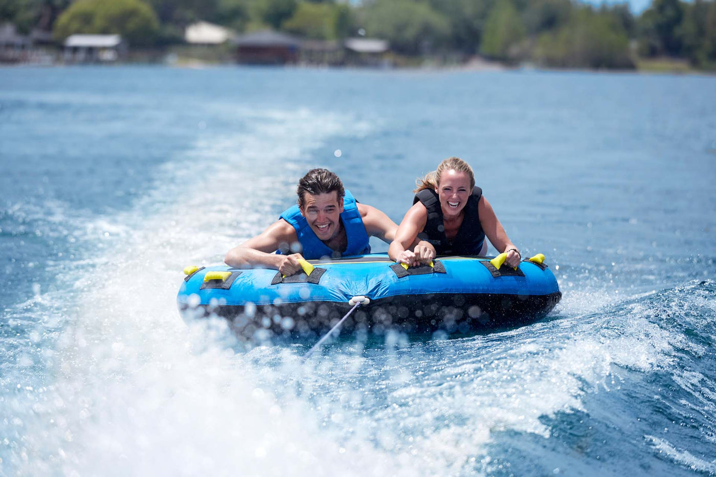 Boy and Girl having fun being towed behind a boat on a Jobe Towable